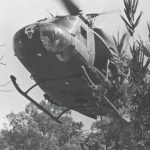 A 57th AHC Huey landing to pick up RT New York in Laos.