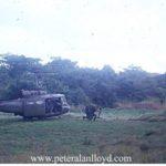 Huey unloads at an LZ (Major Derald Smith 174ahc.org)