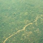 Helicopter over the Ho Chi Minh Trail in Laos (Fred Thompson 174ahc.org).