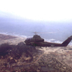 ML 367th Marine AH-1G gunships returning from a mission, flying over Marble Mountain with SOG's Command and Control North's (CCN) and the North Vietnamese Prisoner of War Camp in view