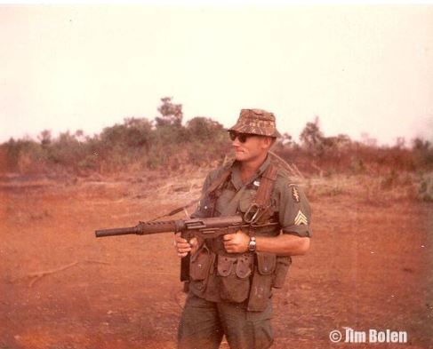 Jim firing the .45 caliber M-3 Silenced Grease Gun that they took on missions, which they put together that night, in case the tiger attacked.