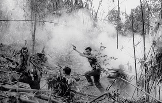 NVA Infantry officer leads an attack