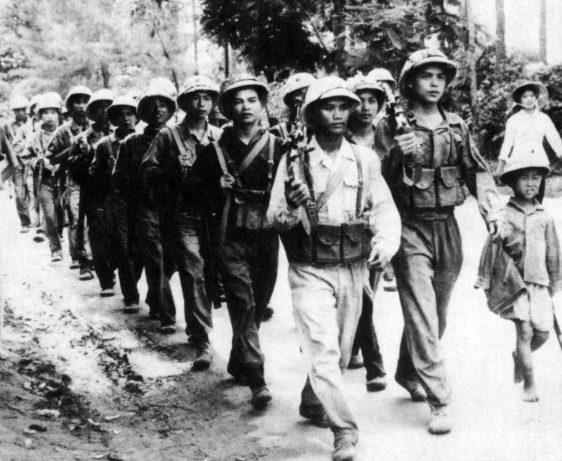 NVA soldiers with child soldier in tow