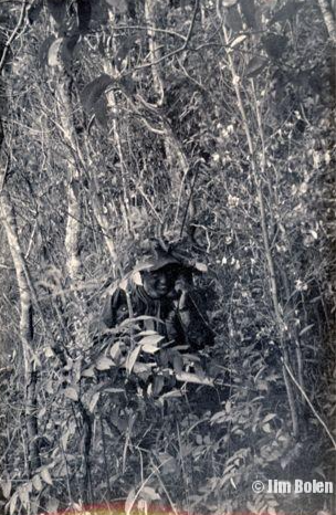 One of Jim's team members, Sgt. Knowles, camouflaged in the jungle inside Cambodia