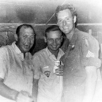 Ray, Manny, and Don in the club after several weeks at the forward launch site. The old guys took care of the kid. I was 24, and they were in their late 30s.