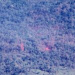 A 20th Helicopter jungle extraction – a chopper hovers over the popped red smoke on the left hand side of the photo. (© Jim Green 20th SOS)