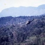 A Gunship attacks (note wisping smoke in the bottom left hand corner of the photo). (© Jim Green 20th SOS)