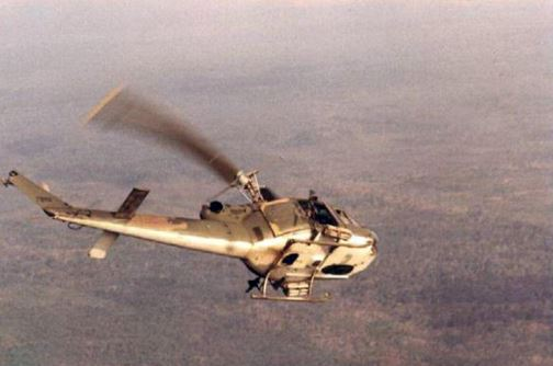 A Huey of the 20th Special Operations Squadron starts its descent (© Jim Green 20th SOS).