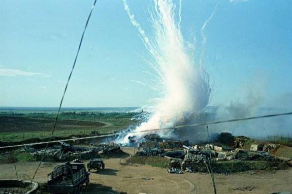 A North Vietnamese 122 mm shell hits a U.S. ammunition bunker at Gio Linh, South Vietnam