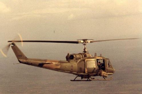 An SOS chopper on its way to an extraction, with a rolled-up ladder outside the door. (© Jim Green 20th SOS)