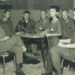 """Spike with CCN troops & Seabees in CCN club. Spike was a Vietnamese orphan who was informally """"adopted"""" by some guys in Recon company."""