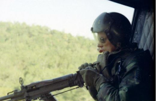 Door gunner of a Helicopter gunship of the 20th Special Air Squadron, making a low pass