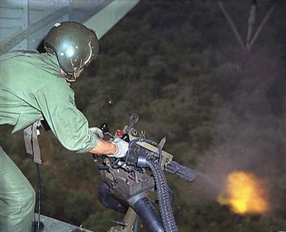 Helicopter door gunner in Vietnam, 1968.