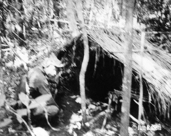 One of Jim's team checks out an NVA storage area on a conventional SOG mission inside Cambodia along the Sihanouk Trail.