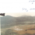 Det A-105, across runway was SOG's camp and beyond that was a village.