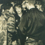 Maggie talks to the troops. Cletis Sinyard (Babysan) wearing the boonie hat. Larry Trimble standing next to Maggie with a mustach. Also Randy Givens and SGM Nameth. Closest to the camera is Jim Lamotte. That night after the festivities Maggie took some of the Recon guys up to the officer's club and she drank vodka and talked the rest of the night.