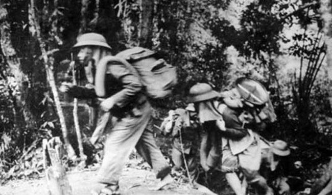 NVA emerge from the jungle onto the Ho Chi Minh Trail