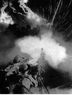 North Vietnamese Anti-Aircraft gun fires at night.