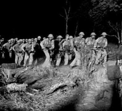North Vietnamese Army soldiers moving down the Ho Chi Minh Trail at night