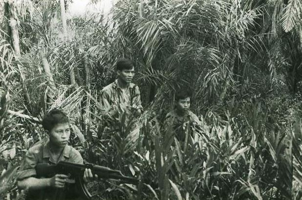 North Vietnamese soldiers ready an ambush in the Laotian jungle.
