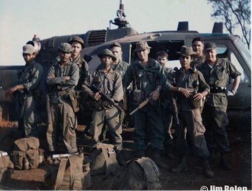 Jim, 4th from the left on front row, and his team RT Auger with the 20th SOS air crew preparing to board a Huey for a more conventional SOG mission to the Sihanouk Trail.