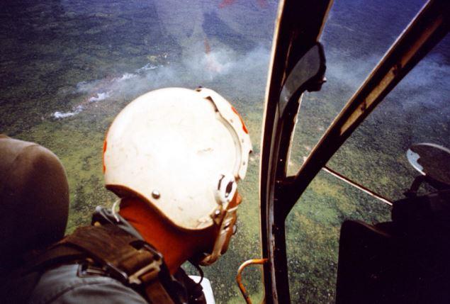 Skyraider pilot looks down having just made a close air strike