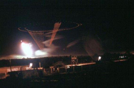 Spooky gunship lays down a cone of fire near MAC-V Team 21 Compound in Pleiku, Vietnam