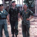 Larry Thorne far right, in Tinh Binh with Major James Lattimore far left and an unknown cpt in the middle. In 1964