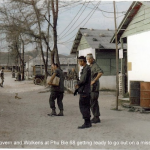 McGovern and Wolkens at Phu Bia 1968 getting ready to go out on a mission.
