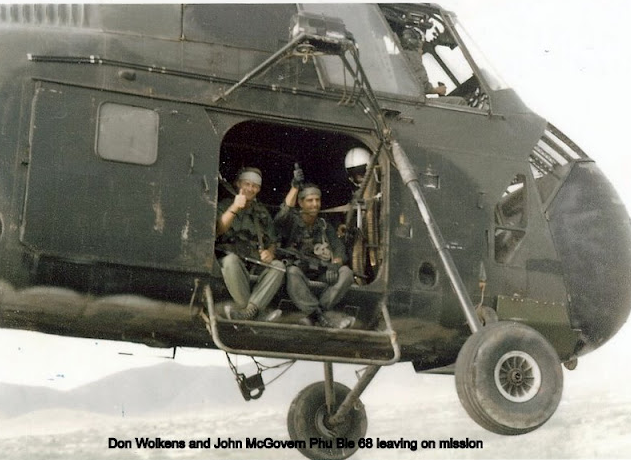 MCGovern and Wolkens at Phu Bia 1968 leaving for a mission.