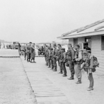 """RT Idaho getting at a pre-mission inspection at CCN, Da Nang in April 1969 next to CCN Headquarters. Team members from right: Cau, Doug """"The Frenchman"""" LeTourneau, Capt. Mike O'Byrne, Hung, Fontenberry, Lynne M. Black Jr., Hiep, Sau, Son and Myself."""