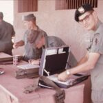 """Payday in Long Thanh, MSG """"Pop"""" Taylor and SSG Bill Deacy and SGT Bill English getting paid."""